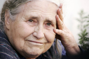 (FILES) In a file picture taken on October 11, 2007 British writer Doris Lessing holds her head in her hands outside her home in north London, as she is told by photographers that she has won the Nobel Literature Prize, after returning from a shopping trip. The Nobel Prize-winning British author Doris Lessing died on November 17, 2013 at the age of 94, her agent said. AFP PHOTO / SHAUN CURRYSHAUN CURRY/AFP/Getty Images